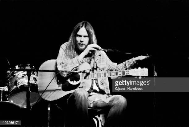 Neil Young performs on stage on the 'Tonight's The Night' tour at the Rainbow Theatre London 5th November 1973