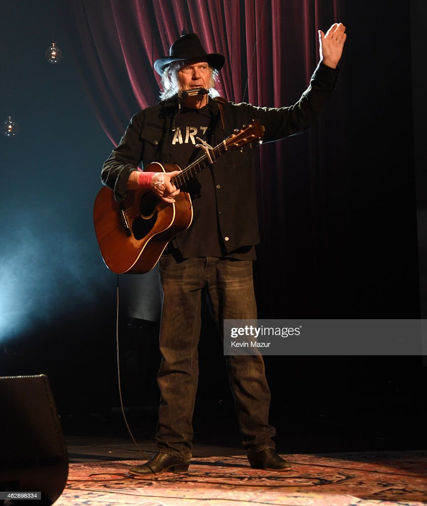Neil Young performs onstage at the 25th anniversary MusiCares 2015 Person Of The Year Gala honoring Bob Dylan at the Los Angeles Convention Center on February 6, 2015 in Los Angeles, California. The annual benefit raises critical funds for MusiCares' Emergency Financial Assistance and Addiction Recovery programs. For more information visit musicares.org.