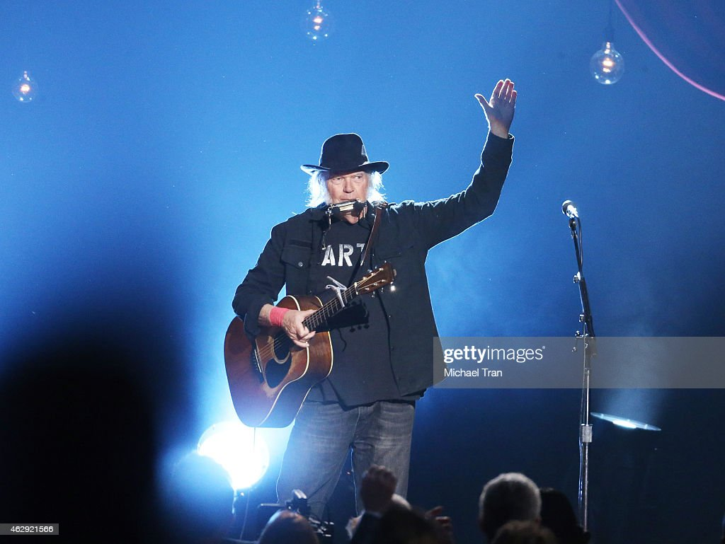 Neil Young performs onstage during the 2015 MusiCares Person of The Year honoring Bob Dylan held at Los Angeles Convention Center on February 6, 2015 in Los Angeles, California.