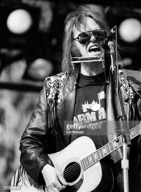 Neil Young performs with CSN Y at the Bill Graham tribute concert at the Polo Fields in Golden Gate Park in San Francisco California November 3 1991