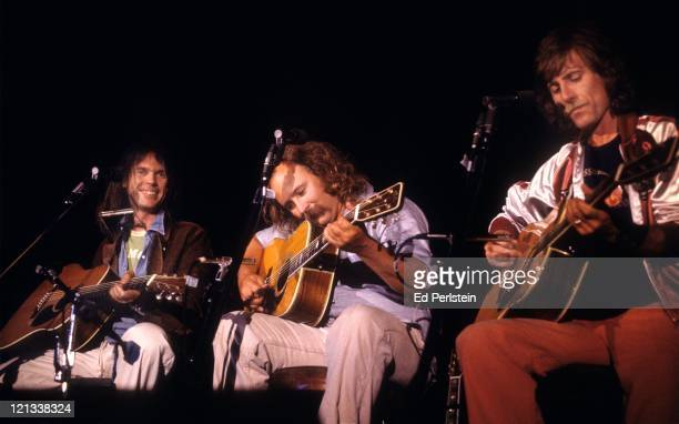 Neil Young performs with David Crosby and Graham Nash as their guest at the Santa Cruz Civic Auditorium in Santa Cruz California August 12 1977