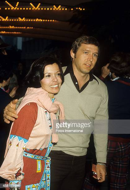 Neile Adams McQueen and boyfriend David Ross pose for a portrait at a movie premiere in April 1977 in Los Angeles California