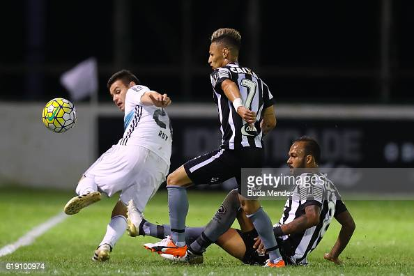 Neilton and Bruno Silva of Botafogo struggle for the ball with Ruy of Coritiba during a match between Botafogo and Coritiba as part of Brasileirao...
