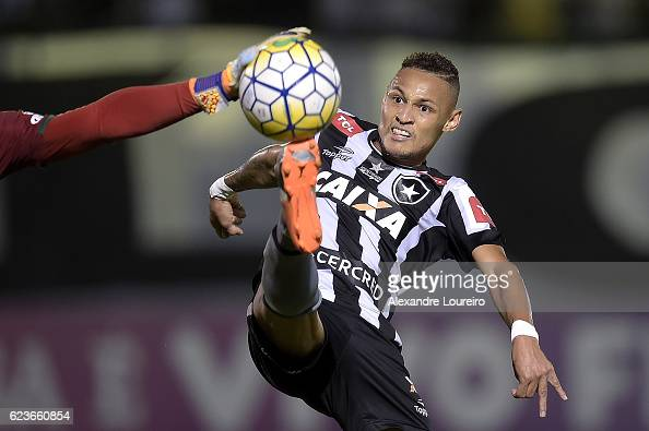 Neilton of Botafogo battles for the ball with Danilo of Chapecoense during the match between Botafogo and Chapecoense as part of Brasileirao Series A...