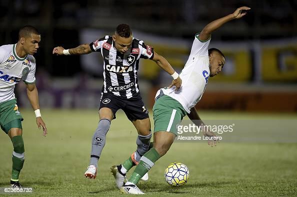 Neilton of Botafogo battles for the ball with Matheus Biteco of Chapecoense during the match between Botafogo and Chapecoense as part of Brasileirao...