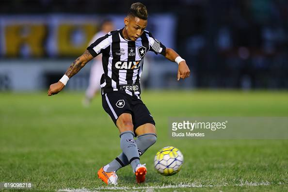 Neilton of Botafogo kicks the ball during a match between Botafogo and Coritiba as part of Brasileirao Series A 2016 at Luso Brasileiro stadium on...
