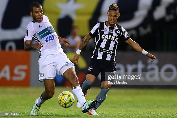 Neilton of Botafogo struggles for the ball with Amaral of Coritiba during a match between Botafogo and Coritiba as part of Brasileirao Series A 2016...