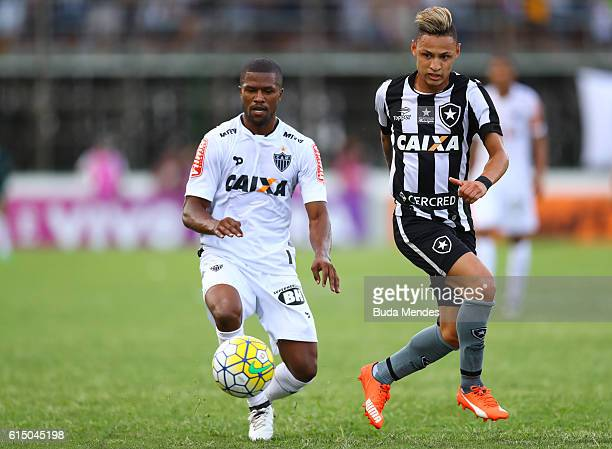 Neilton of Botafogo struggles for the ball with Carlos Cesar of Atletico Mineiro during a match between Botafogo and Atletico Mineiro as part of...