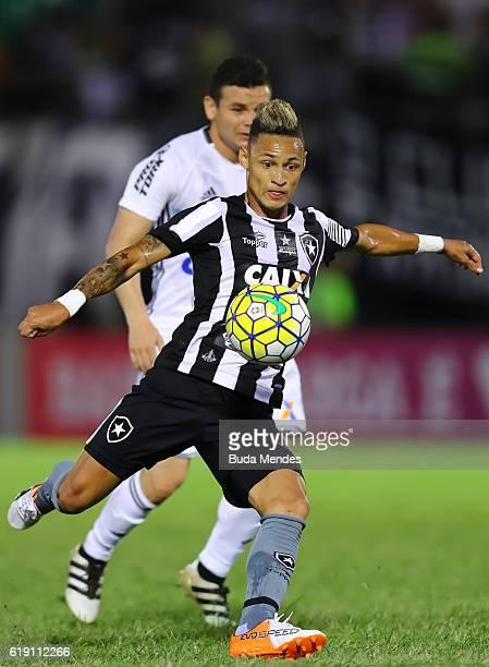 Neilton of Botafogo struggles for the ball with Ruy of Coritiba during a match between Botafogo and Coritiba as part of Brasileirao Series A 2016 at...