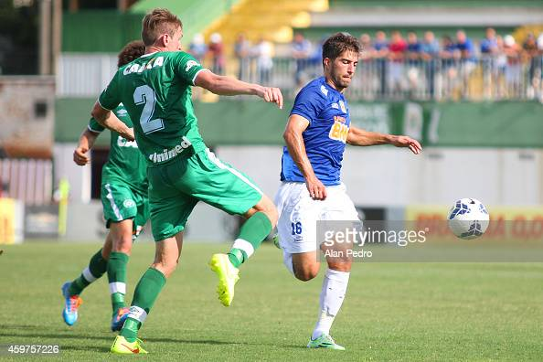 Neilton of Cruzeiro plays for the ball with a Fabiano of Chapecoense during a match between Chapecoense and Cruzeiro for the Brazilian Series A 2014...