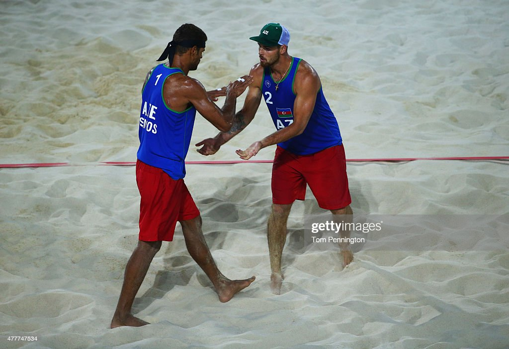 Neilton Santos and Iaroslav Rudykh of Azerbaijan celebrate during the Men's Beach Volleyball elimination round match between Azerbaijan and Ukraine...