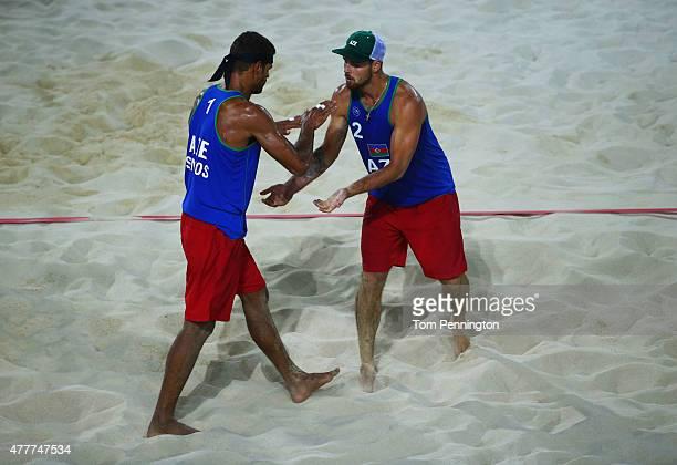 Neilton Santos and Iaroslav Rudykh of Azerbaijan celebrate during the Men's Beach Volleyball elimination round match between Azerbaijan and Ukraine...