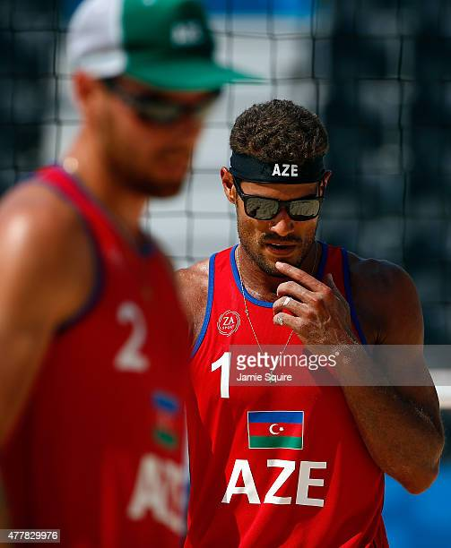 Neilton Santos and Iaroslav Rudykh of Azerbaijan walk off the court after being defeated by Martins Plavins and Haralds Regza of Lithuania in the...