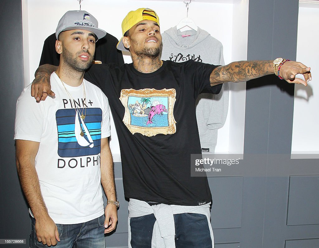 Neima Khaila (L) and Chris Brown attend special in-store meet and greet held at Pink+Dolphin on November 7, 2012 in Los Angeles, California.