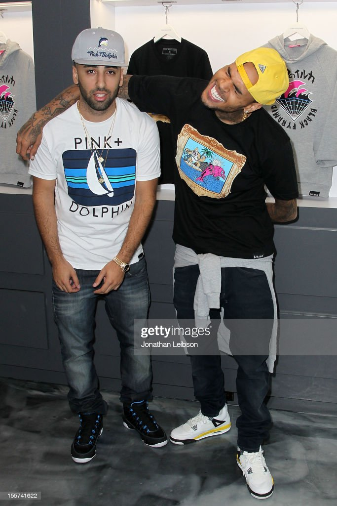 Neima Khaila and Chris Brown attend the In-Store Meet and Greet Celebration At Pink+Dolphin's Fairfax Location at Pink+Dolphin on November 7, 2012 in Los Angeles, California.