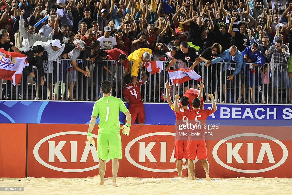 Neimanu Taiarui of Tahiti jumps into the crowd to celebrate after scoring during the FIFA Beach Soccer World Cup Tahiti 2013 Quarter Final match between Argentina and Tahiti at the Tahua To'ata Stadium on September 25, 2013 in Papeete, French Polynesia.
