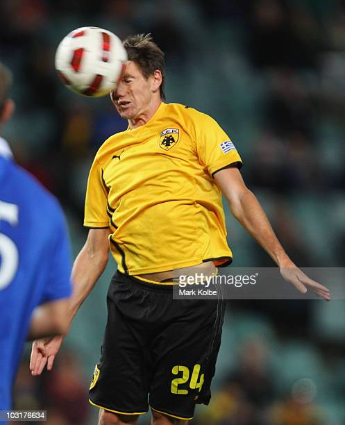 Neithan Burns of Athens heads the ball to score a goal during the preseason friendly match between AEK Athens FC and Glasgow Rangers at the Sydney...