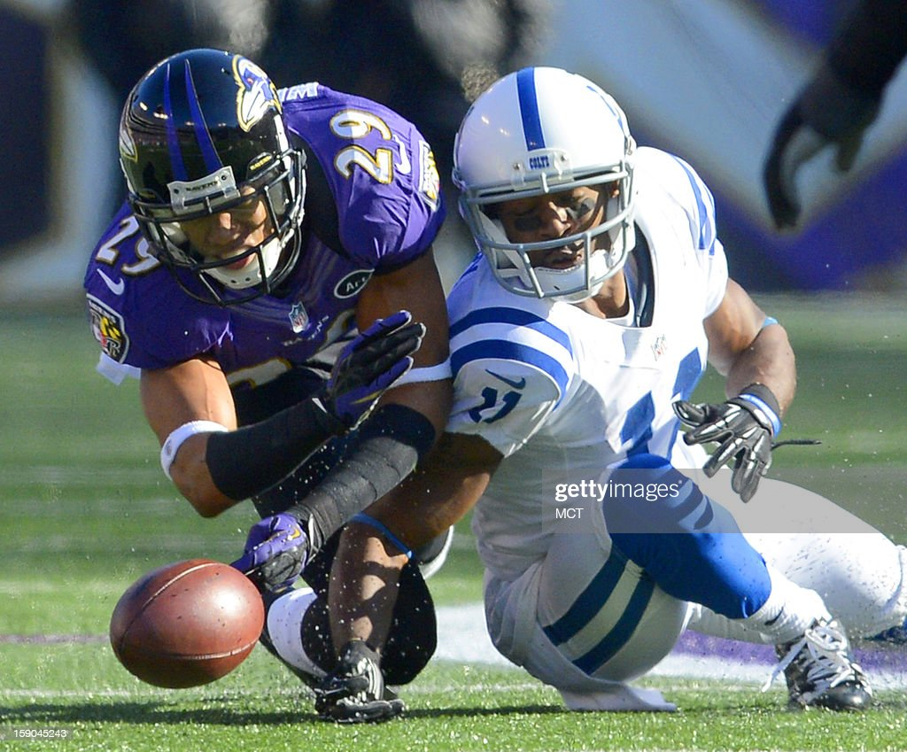 Neither Indianapolis Colts wide receiver Donnie Avery nor Baltimore Ravens cornerback Cary Williams can come up with a deflected pass during the first half of their AFC playoff game in Baltimore, Maryland, on Sunday, January 6, 2013.