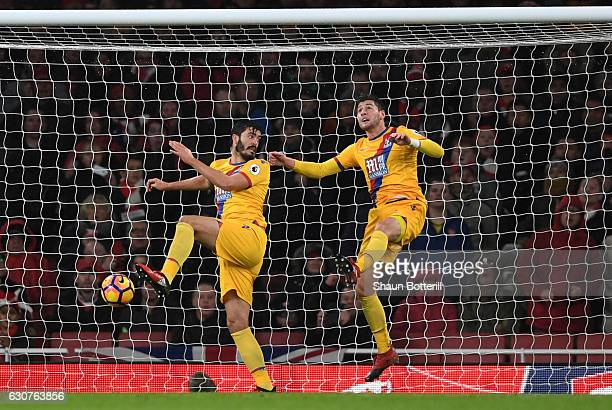 Neither James Tomkins or Joel Ward of Crystal Palace can prevent Alex Iwobi of Arsenal from scoring his team's second goal during the Premier League...
