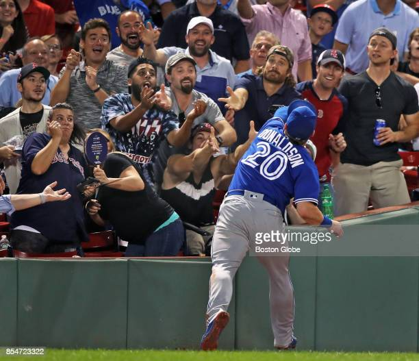 Neither the fans nor Toronto third baseman Josh Donaldson can make the catch on a bottom of the sixth inning foul ball off the bat of Red Sox player...