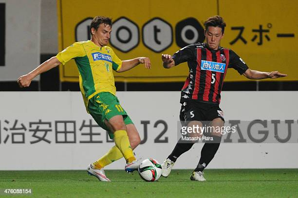 Nejc Pecnik of JEF United Chiba and Kazuki Kushibiki of Consadole Sapporo compete for the ball during the JLeague second division match between JEF...
