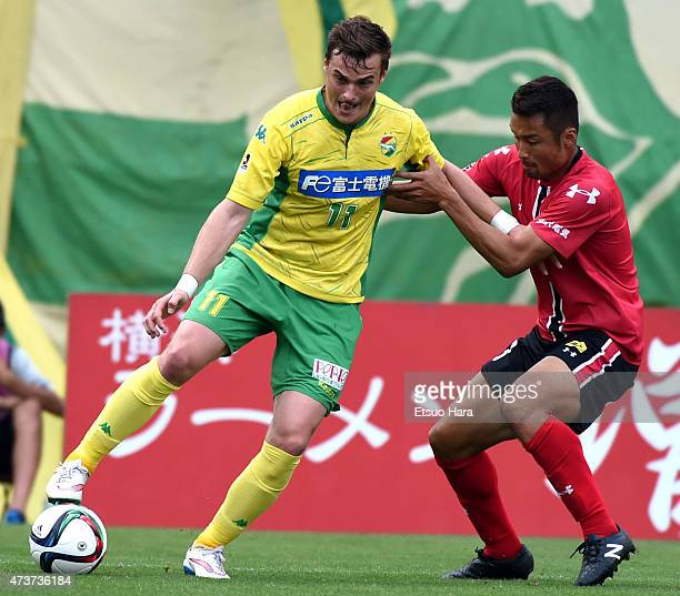 Nejc Pecnik of JEF United Chiba and Yuji Sakuda of Zweigen Kanazawa compete for the ball during the JLeague second division match between JEF United...