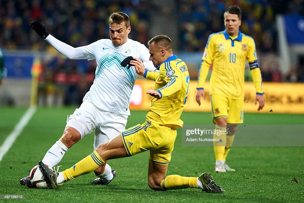 Nejc Pecnik of Slovenia fights for the ball with Vyacheslav Shevchuk from Ukraine during the UEFA EURO 2016 Playoff for Final Tournament First leg...