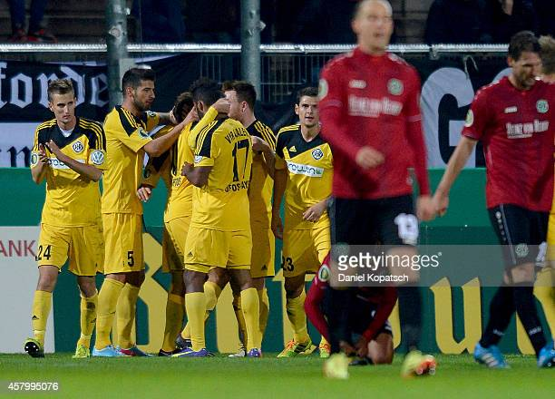 Nejmeddin Daghfous of Aalen celebrates his team's first goal with team mates during the DFB Cup second round match between VfRAalen and Hannover 96...