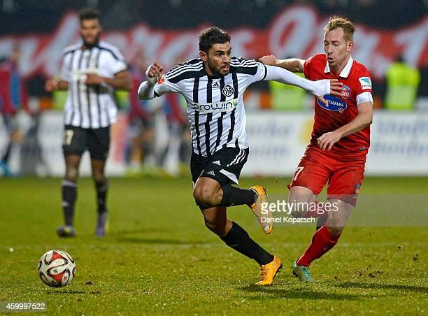 Nejmeddin Daghfous of Aalen is challenged by Marc Schnatterer of Heidenheim during the second Bundesliga match between 1 FC Heidenheim and VfR Aalen...