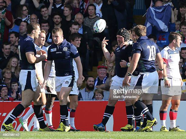 Nel of Scotland celebrates scoring a Try late in the second half with his team mates during the 2015 Rugby World Cup Pool B match between Scotland...