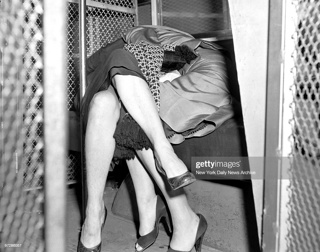Nela Bogacki, alias Nella Bogart, madam of the 'Continental call girl ring,' handcuffed to Salema Hontover after being seized by the F.B.I. Both are to be deported for illegal entry.