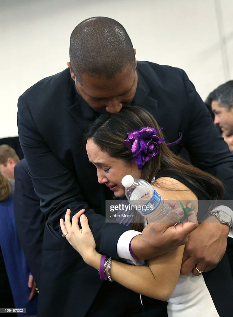 Nelba Marquez Greene and her husband Jimmy Green whose daughter Ana Grace Marquez Green (6), was killed in the Sandy Hook massacre, embrace during a press conference on the one month anniversary of the Newtown elementary school massacre on January 14, 2013 in Newtown, Connecticut. Eleven families of Sandy Hook massacre victims came to the event one month after the shooting to give their support to Sandy Hook Promise, a new non-profit with the goal of preventing such tragedies in the future.