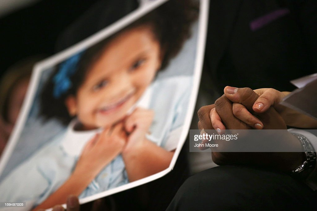 Nelba Marquez Greene and her husband Jimmy Green whose daughter Ana Grace Marquez Green (age 6 in photo), was killed in the Sandy Hook massacre, hold hands during a press conference on the one month anniversary of the Newtown elementary school massacre on January 14, 2013 in Newtown, Connecticut. Eleven families of Sandy Hook massacre victims came to the event one month after the shooting to give their support to Sandy Hook Promise, a new non-profit with the goal of preventing such tragedies in the future.