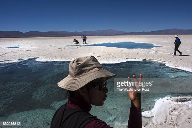 Nelda Lamas a local indigenous guide says that communities have a spiritual connection with the pools known as 'eyes' in the Salinas Grandes salt...