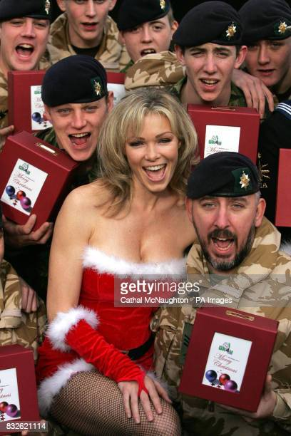 Nell McAndrew pictured with members of the Worcesters and Foresters battalion at Regents Park Barracks central London with the last of 25000 gift...