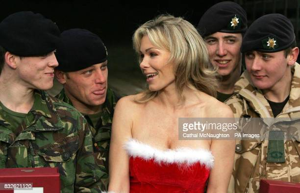 Nell McAndrew pictured with members of the Worcesters and Foresters battalion at Regents Park Barracks central London with one of the last of 25000...