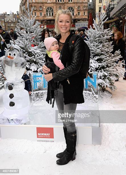 Nell McAndrew with her daughter Anya attend Disney's 'Frozen' celebrity screening at the Odeon Leicester Square on November 17 2013 in London England