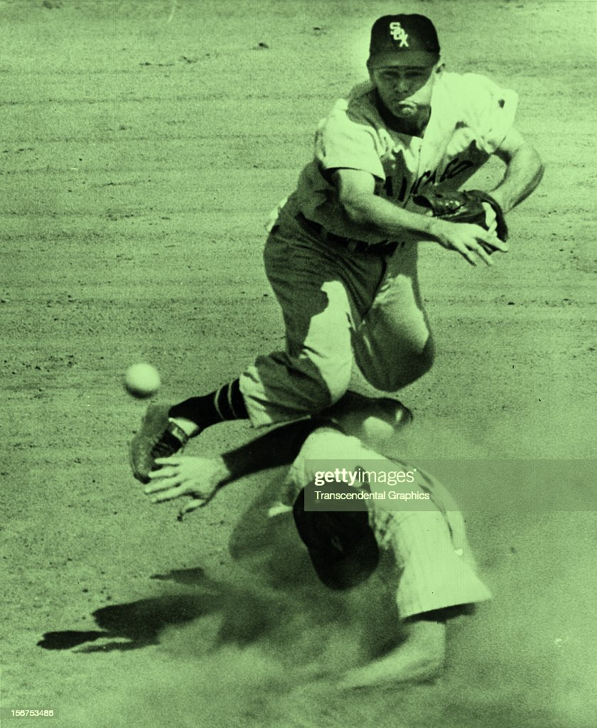 Nellie Fox completes a double play against the Yankees in 1959 in Yankee Stadium in New York City.