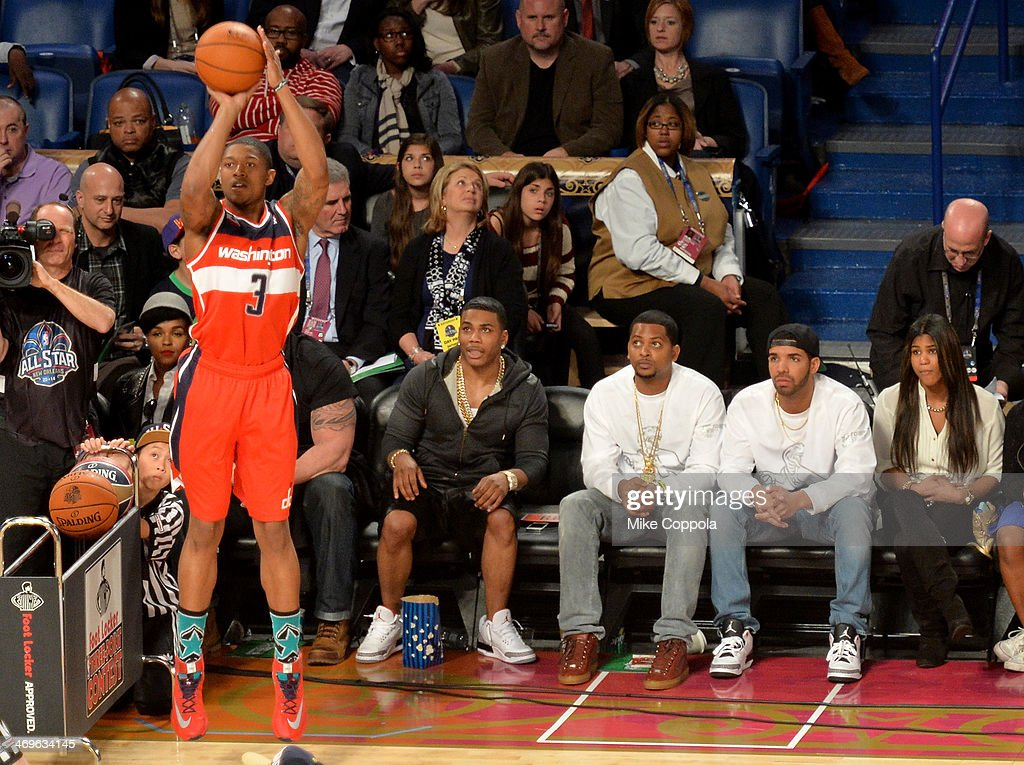 Nelly and Drake attend the Foot Locker ThreePoint Contest at the State Farm AllStar Saturday Night during the NBA AllStar Weekend 2014 at The...