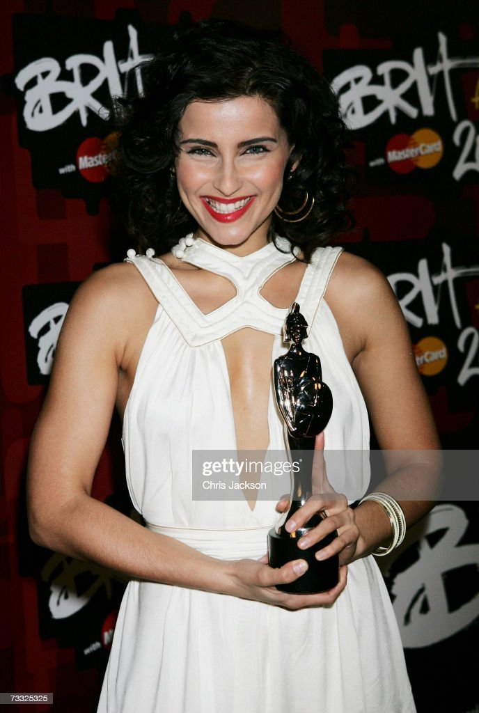Nelly Furtado poses in the awards room after winning the award for best International Female Solo Artist at the BRIT Awards 2007 in association with MasterCard at Earls Court on February 14, 2007 in London.