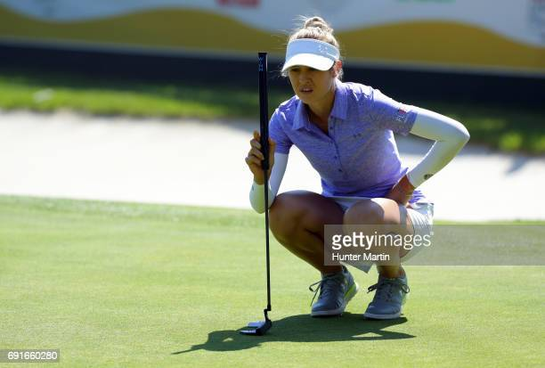 Nelly Korda lines up her putt on the 18th hole during the first round of the ShopRite LPGA Classic presented by Acer on the Bay Course at Stockton...