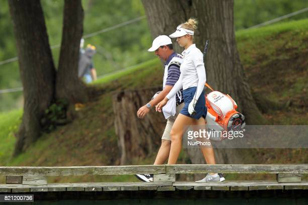 Nelly Korda of the United States and her caddie cross the bridge on the way to the second green during the third round of the Marathon LPGA Classic...