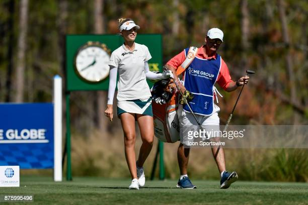 Nelly Korda of the United States exchanges her club with her caddie after a successful tee shot on the eighth hole during the third round of the LPGA...