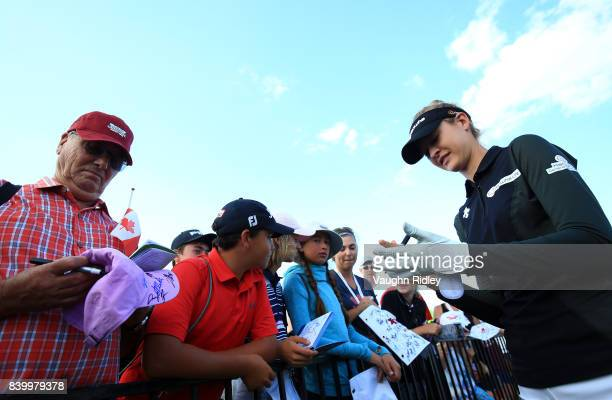 Nelly Korda of the United States signs autographs for fans following the final round of the Canadian Pacific Women's Open at the Ottawa Hunt Golf...