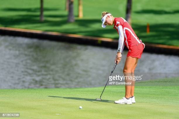 Nelly Korda of the US putts during the Blue Bay LPGA golf tournament at Jian Lake Blue Bay Golf Course on China's southern Hainan island on November...