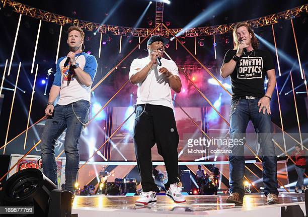 Nelly performs onstage with Brian Kelley and Tyler Hubbard of Florida Georgia Line during the 2013 CMT Music Awards Rehearsals Day 1 at Bridgestone...