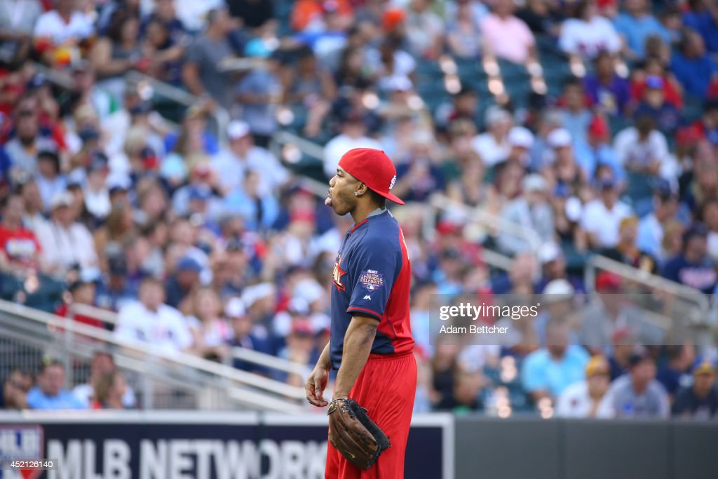 Nelly sticks his tongue out at the crowd during the 2014 MLB All-Star legends and celebrity softball game on July 13, 2014 at the Target Field in Minneapolis, Minnesota.