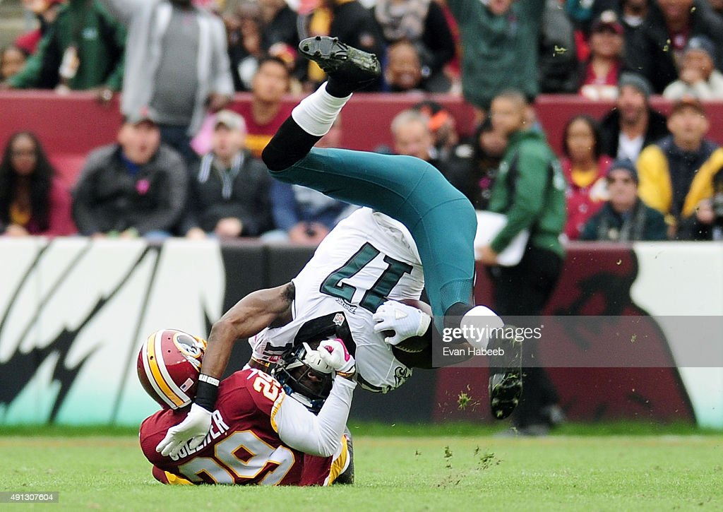 Nelson Agholor of the Philadelphia Eagles is tackled by Chris Culliver of the Washington Redskins at FedExField on October 4 2015 in Landover Maryland