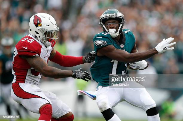 Nelson Agholor of the Philadelphia Eagles makes a 72yard catch and runs the ball in for a touchdown as Budda Baker the Arizona Cardinals during the...