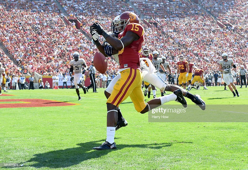 Nelson Agholor #15 of the USC Trojans misses a catch in the endzone as he is defended by Nevin Lawson #1 of the Utah State Aggies during a 17-14 Trojan win at the Los Angeles Memorial Coliseum on September 21, 2013 in Los Angeles, California.